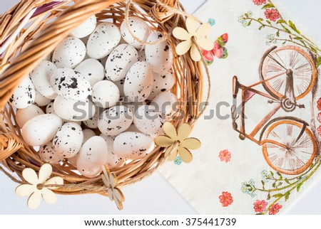 Easter eggs basket decoration. Little black and white eggs in basket. Little eggs in basket. Easter background. Flowers - stock photo