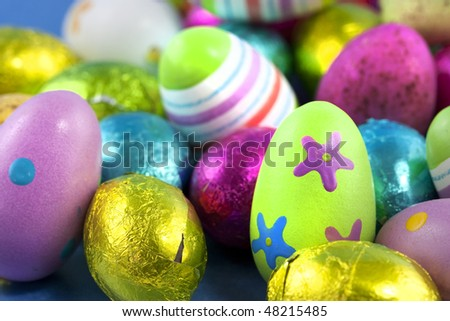 easter eggs chocolate and painted macro studio shot - stock photo