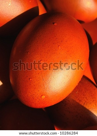 Easter eggs, coloured with onion skin - stock photo