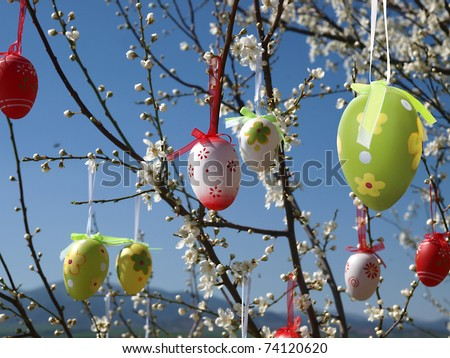 Easter eggs decorated on blooming tree - stock photo