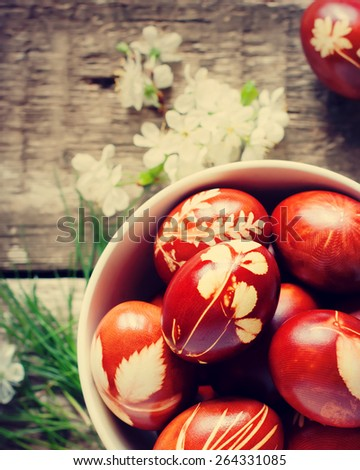 Easter Eggs Decorated with Natural Fresh Leaves and Boiled in Onions Peels. Toned - stock photo