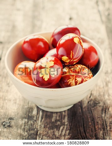 Easter eggs Decoration with fresh Leaves and boiled in Onion peels, toned Image - stock photo