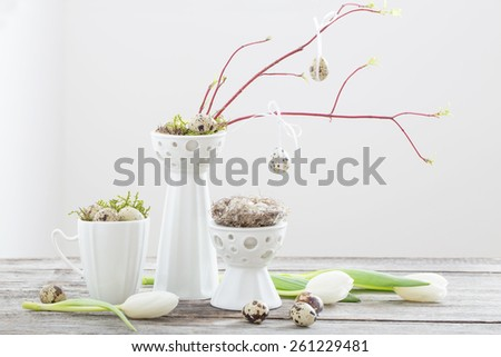 Easter eggs decorations on wooden table - stock photo