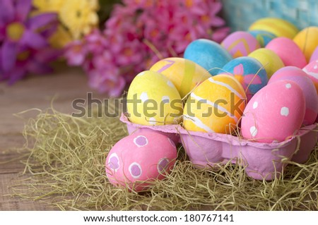 Easter Eggs Dyed by Kids in Rustic Still Life with Colorful Spring Flowers in Bokeh, with background room or space for copy, text, words.  Horizontal - stock photo