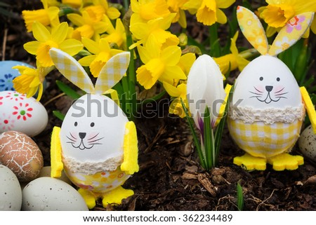 Easter eggs, easter bunnies, daffodils - stock photo