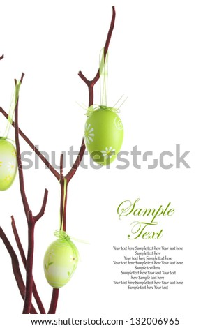 Easter eggs hanging on a branch - stock photo