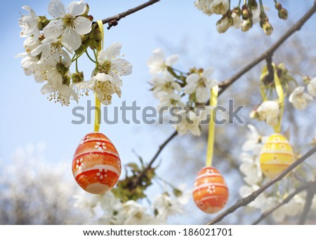 Easter eggs hanging on the blooming tree - stock photo