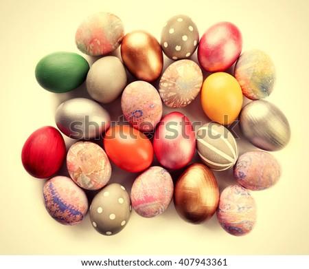 Easter eggs heap on table.Retro stylization - stock photo
