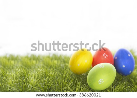 Easter eggs hiding in the grass. Happy Easter. - stock photo