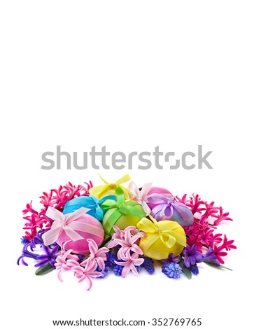 Easter eggs, hyacinth and muscari on white background with space for text. - stock photo