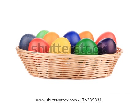 Easter eggs in a basket. Isolated on a white background.