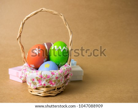 Gift basket stock images royalty free images vectors shutterstock easter eggs in a basket weave wood and gift box on the left corner on a negle Image collections