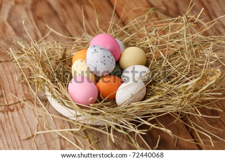 Easter eggs in a bird's nest - stock photo