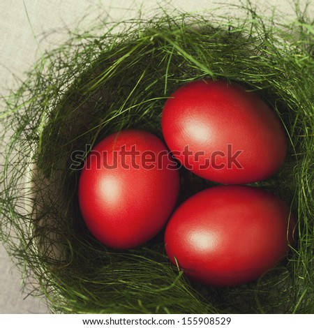 Easter eggs in a bowl decorated with a nest - stock photo