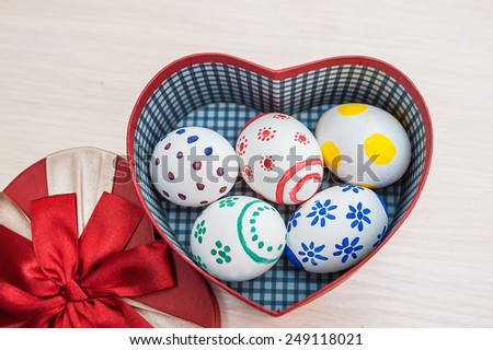 Easter eggs in a box in the shape of heart. - stock photo