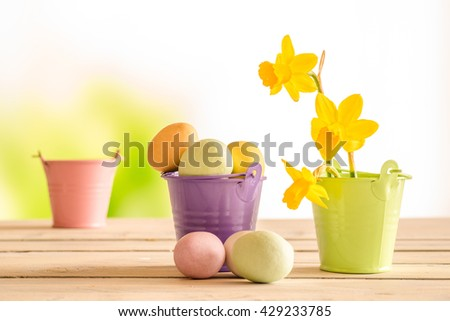 Easter eggs in a purple bucket in the easter - stock photo