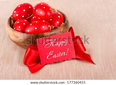 Easter eggs in a wooden bowl - stock photo