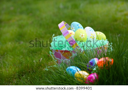Easter Eggs in Basket and in Grass