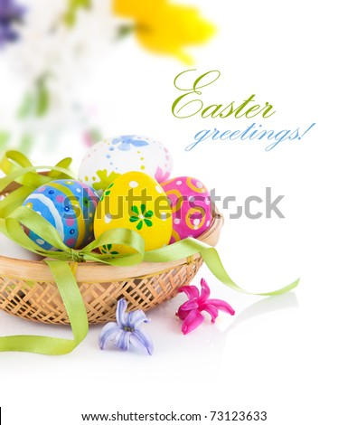 easter eggs in basket with bow isolated on white background - stock photo