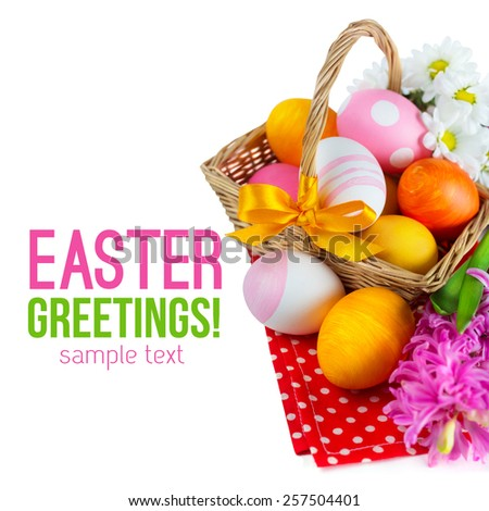 Easter Eggs in basket with bow isolated on white background, with sample text - stock photo