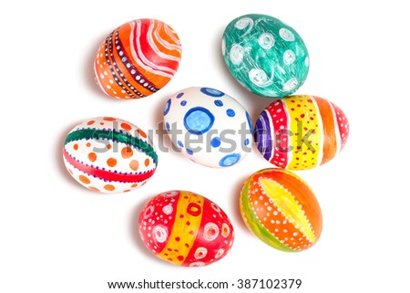 Easter eggs in beautiful and different colors on a white isolated background