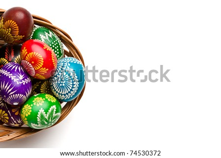 Easter eggs in bowl on white background
