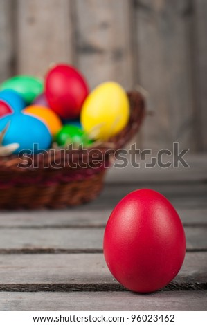 Easter eggs in  brown pannier-one red egg is out