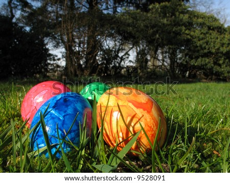 Easter eggs in garden - stock photo