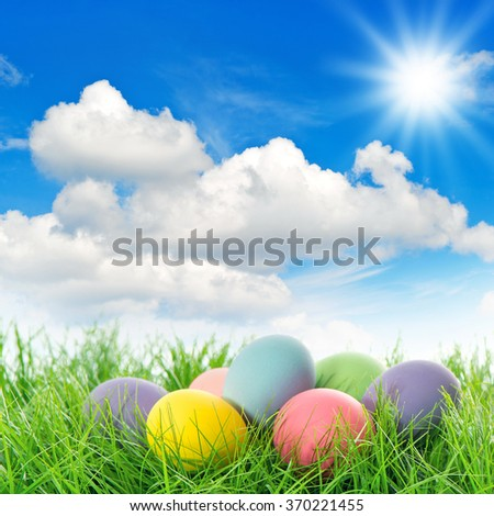 Easter eggs in green grass. Spring landscape. Holidays background