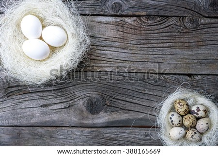 Easter eggs in nest over vintage wood. Top view with tag for copy space - stock photo