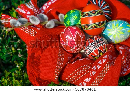 Easter eggs in red embroidered towel with pussy-willow branches. easter background. happy easter - stock photo