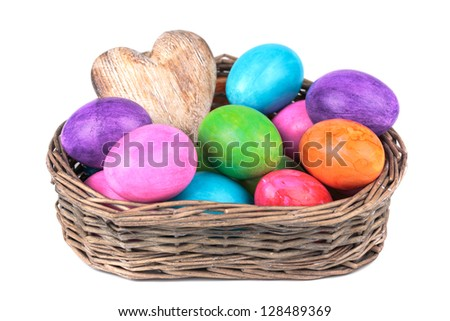 Easter eggs in the basket  on a white background