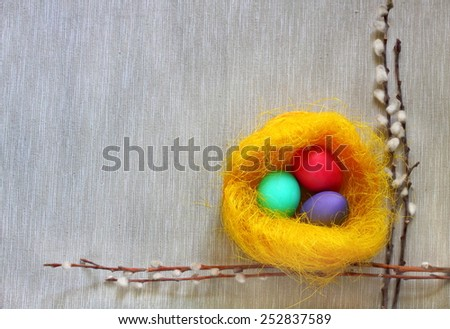 Easter eggs in the decorative nest - stock photo