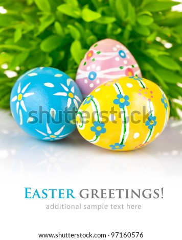 Easter eggs in the green grass isolated on white background - stock photo