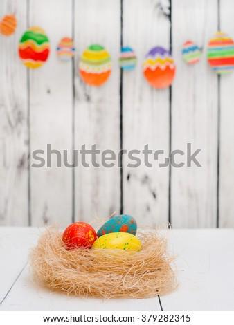 Easter eggs in the nest - stock photo