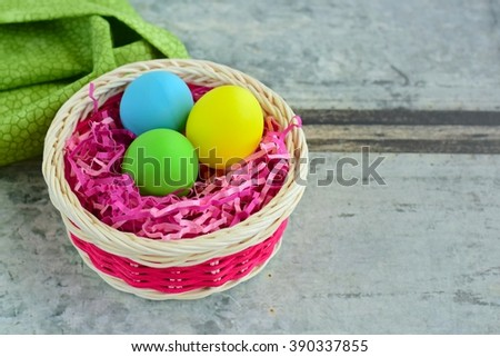 Easter eggs in the nest on basket