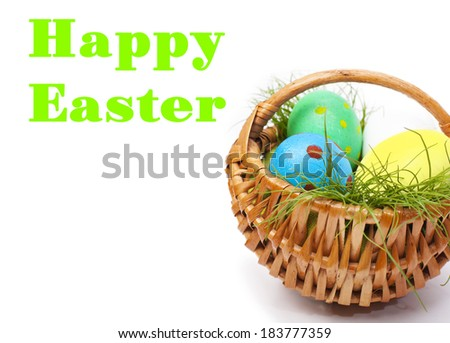 Easter eggs in wicker on white background with space for text - stock photo