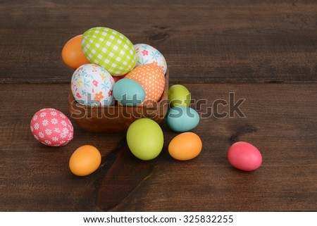 easter eggs in wooden bowl - stock photo