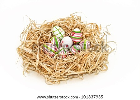 Easter eggs into a nest as Easter theme