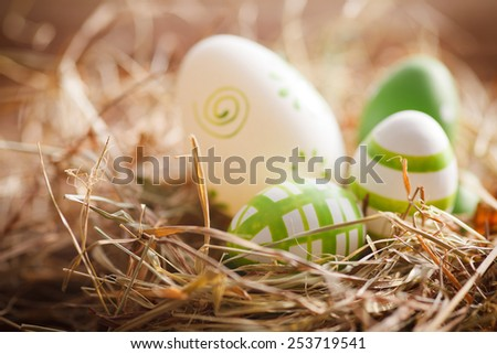 easter eggs lying in hay - stock photo