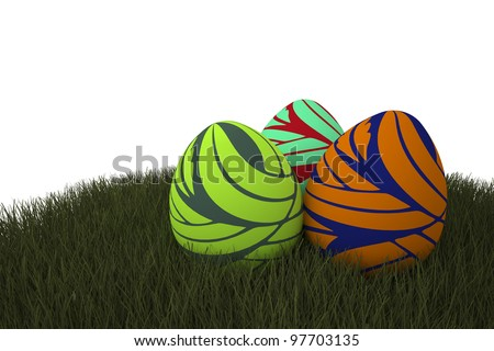 Easter eggs lying on green grass - stock photo