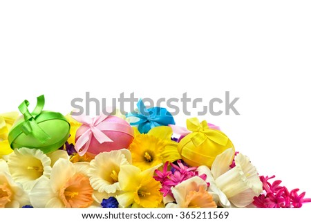Easter eggs, narcissus and hyacinth on white background with space for text. - stock photo