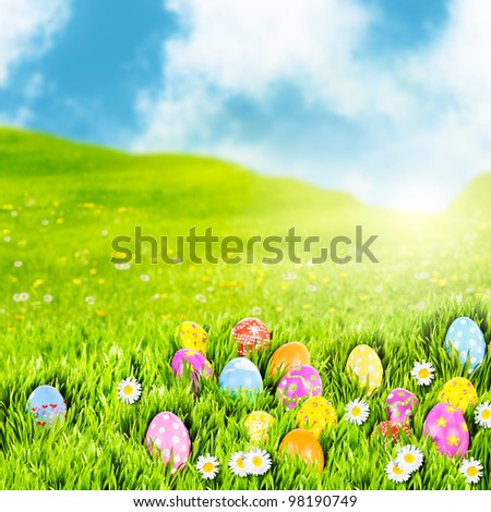 Easter eggs nestled in a sunny meadow