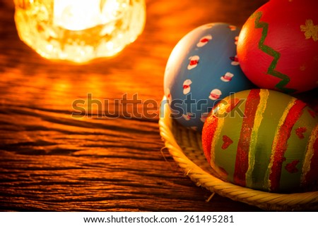 Easter eggs on basket - stock photo