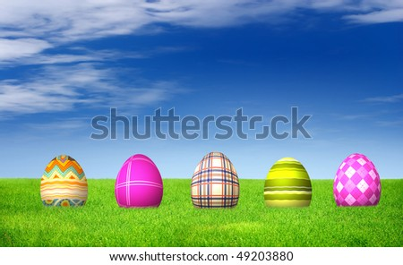 Easter Eggs on grass field under blue sky and white clouds