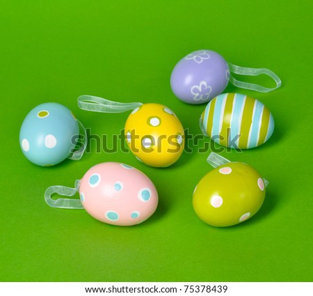 Easter eggs on green background with copy space - stock photo
