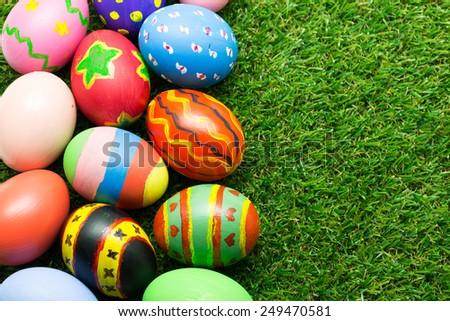 Easter eggs on green grass - stock photo