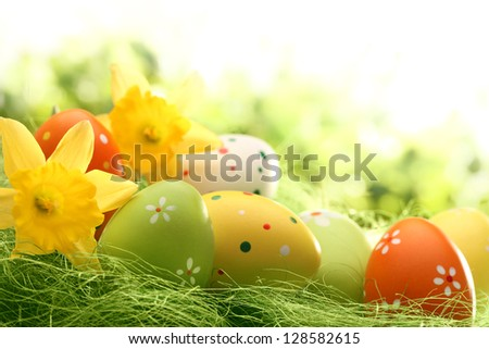 Easter eggs on meadow in springtime - stock photo