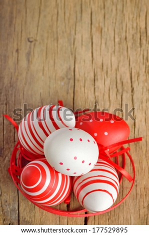 easter eggs on old wood - stock photo
