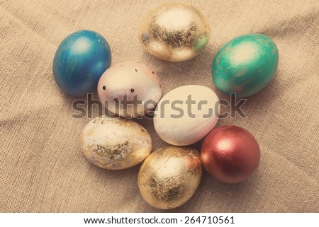 Easter eggs on table. Holiday background. Tinted photo. - stock photo
